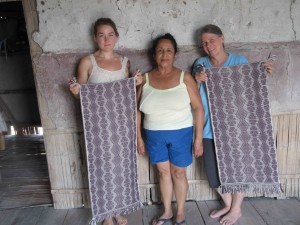 Amber and Janet with their instructor doña Trinidad show off their finished wall-hangings which are ready to hang.